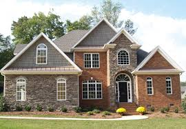 houses with stone accents. Wonderful With Accents For Red Brick Homes  Mixed Media Using Brick And Stone In Home  Facades On Houses With Stone I