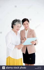 Financial Advisor Retirement Senior Woman Meeting With Financial Advisor For Retirement