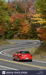car driving down road. Modren Down Car Driving Down Winding Road Through Autumn Forest In The Keweenaw  Peninsula Upper To I