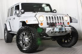 the white chrome and rhino custom jeep wrangler by eastchester customs