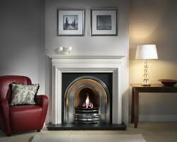 interior white stone mantel shelf with black fireplace on white wall and black floor