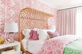 resplendent eclectic pink girl s bedroom boasts a beautiful rattan bed covered in a pink and blue fl duvet topped with a green fl throw and