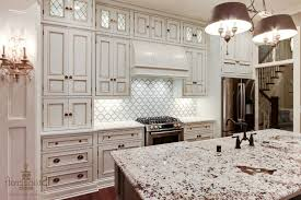 gray accents and glass pendant lights backsplash ideas with white cabinets and dark countertops grey tile