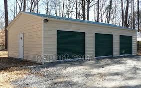 long metal garage building sample showing three roll up doors and one entry door