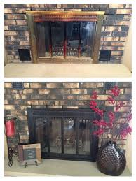 painted old brass fireplace cover with rustoleum high heat black paint love the new