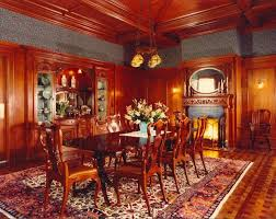 formal dining room with wood panel walls and detailed wood celling traditional dining room