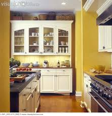 kitchen wall cabinets with glass doors awesome kitchens yellow walls with custom made off white cabinets