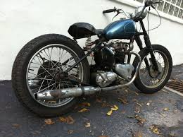 me and this motorcycle new toy 1951 triumph 5t speed twin bobber