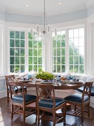Traditional dark wood floor dining room idea in New York with blue walls