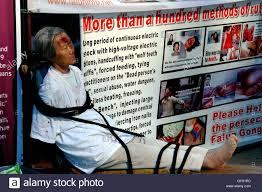 new york city chinese woman wearing se makeup simulating wounds and blood at a falun gong protest demonstration