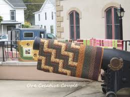 Airing of the Quilts Continued @ One Creative Couple & Lovely fall leaves very visible in this photo and adding to the beauty of  the quilt I might add. ; ) Adamdwight.com