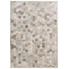 palika global bazaar honeycomb beige grey cowhide rug 2x3 kathy kuo home