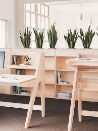 an adjule pure cnc standing desk matching the aesthetic of the original desk