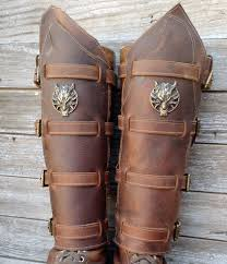 primitive viking brown leather shin guards or gaiters with antique brass fenrir the wolf and hardware by vampieoodles on