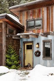 exterior door roof overhang. rustic metal siding entry with yellow front door reclaimed wood exterior roof overhang o