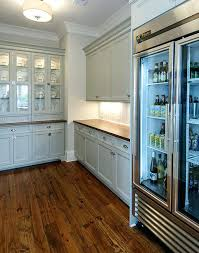 refrigerator with clear doors glass door refrigerator and filled bottles beer and wood floor laminate also