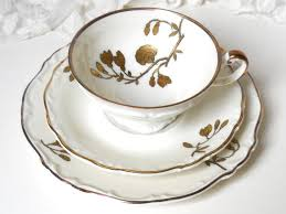 Decorating With Teacups And Saucers Beautiful vintage teacup trio with a gold decoration on off white 71
