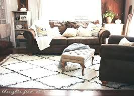area rug with brown couch extraordinary area rug with brown couch leather family room blue finding