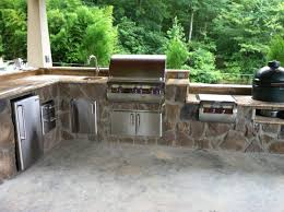 this is a custom outdoor kitchen with a built in fire magic grill and a big