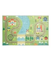 love this green blue train track play prismatic rug