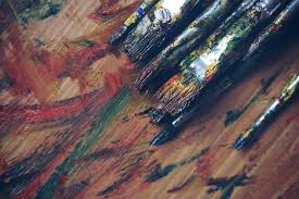 paintbrushes that are full of paint