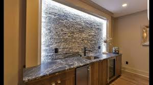 dark color granite countertops bartop with sink cutout with dark cabinets and led lights