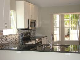 contemporary kitchen with gray metal combined mosaic glass tile backsplash single handle pull down kitchen