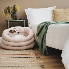 A pink dog bed by Hunting Pony. The pet ...