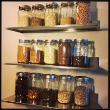 I really like the clean look of the stainless steel shelves and how they  match the tops of the mason jars and the other kitchen appliances.