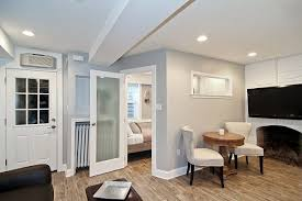 View in gallery Light colors in a basement renovation
