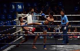 fighter dodges during muay thai fight in bangkok thailand