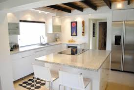 best kitchen remodel ideas -- kitchen renovation with open floor plan and  exposed ceiling beams