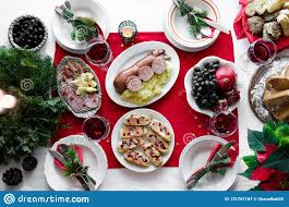 holiday dinner flat lay of festive table setting for holiday dinner with dishes