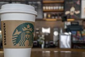 starbucks coffee cup. Wonderful Starbucks Paper Cup In A Starbucks Coffee Shop In Coffee Cup U