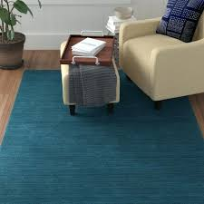 hand loomed turquoise area rug ana red barrel studio