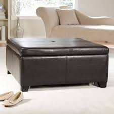 living room features square black leather ottoman coffee