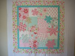 Sweet Flower Wall Hanging - The Quilted Fish & I used curvy lines done with the walking foot in the center of the wall  hanging. I stopped and started around the flowers wherever needed. I then  did stitch ... Adamdwight.com