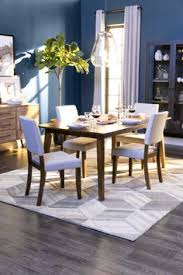 our cora dining collection includes a cal clean lined table and tailored upholstered side chair that are available separately or in this 5 piece set