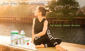 a sitting beside herbalife shake