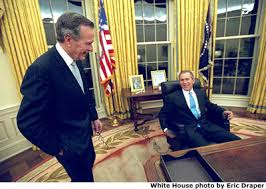 first days photo essay photo one president george w bush sits at his desk in the oval office for the first