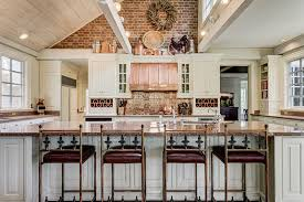 country kitchen with copper decor above cabinets and copper oven hood
