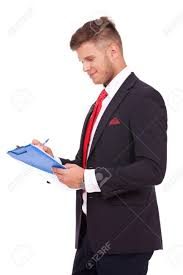 young business man sketching something on his clipboard and stock photo young business man sketching something on his clipboard and smiling while looking at it isolated on white background