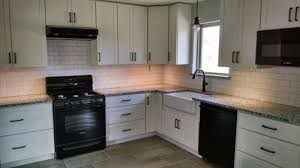 Image Here Is Our New Kitchen Most Of It Anyway What Is Not In This Photo Is Our Bar And Skinny Pantry It Was Covered Up With Construction Material Houzz Poll White Cabinets Black Appliances Granite And Orb Cabinet Pulls