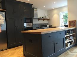 picture of dark grey kitchen with solid wood worktops
