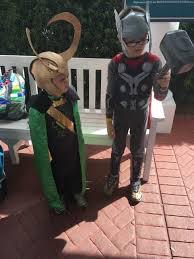 kids in diy loki costume and loki helmet and thor costume