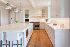 Fine Modern White Kitchen Wood Floor A Trio Of Industrial Pendants Illuminate Throughout Simple Ideas