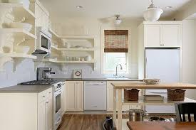small kitchen island with open shelves for the traditional kitchen in white design erotas