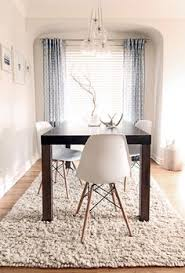 dining e eiffel chairs with dark wood table
