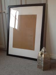 large ikea black wooden picture photo frame with white mount