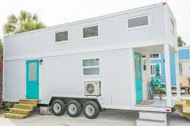 tiny houses florida. The Interior Of Home Has White Walls With Turquoise Accents And Soaring Ceilings. Windows Fill Natural Light A Ceiling Fan Circulates Tiny Houses Florida